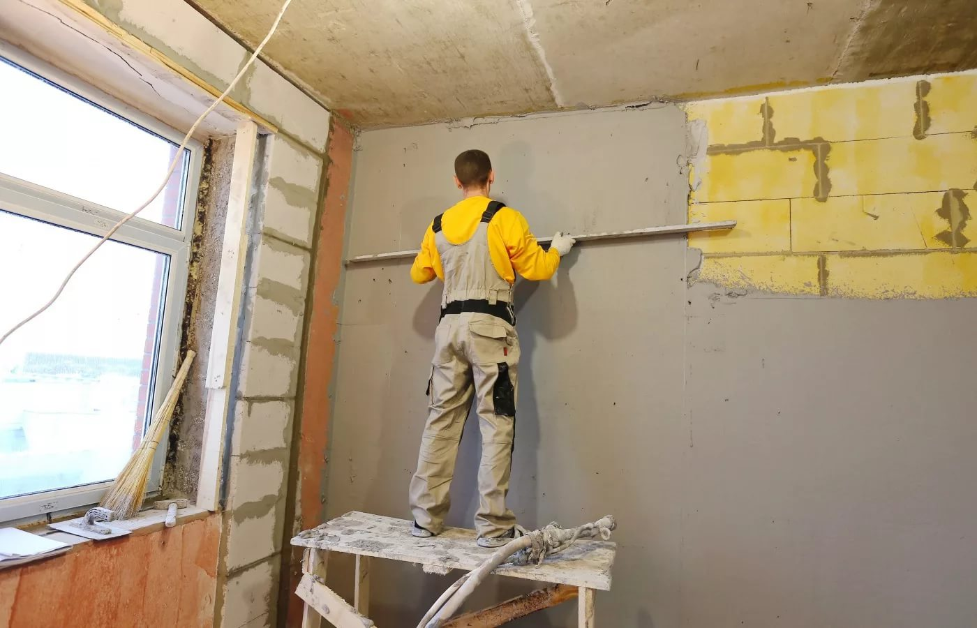 how to repair holes in plaster walls